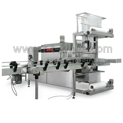 Compact group packaging machine into shrinking film 6000 bottles / hour